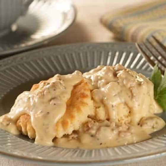 Down Home Sausage Gravy Over Biscuits. Delicious cream gravy with breakfast sausage, served over biscuits.